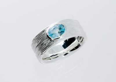 Crease ring with blue topaz